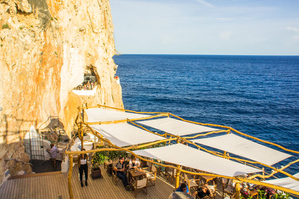 Drinks in a Cave at Cova D'En Xoroi in Menorca, Spain    The Travel Tester